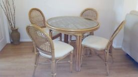Cane table and chairs with glass top