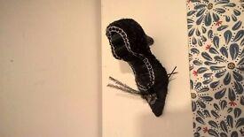 Black shoe ring holder