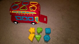 Shape sorting bus toy