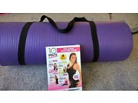 Pilates mat and DVD collection, used once.
