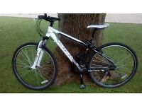 Carrera hybrid bike 21 speed brought new bike forces reluctant sale.