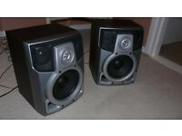 large pair of hifi speakers with speaker wire