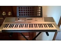 Yamaha PSR E313 electric keyboard with stand