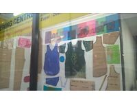 Learn how to measure, cut and sew clothes at the sewing centre in Oldham Town.