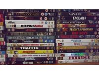 100 DVD's of various films as in photographs
