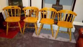 Set of 4 bow chairs.
