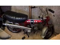 honda 72cc monkey motorcycle made in 1975 is red