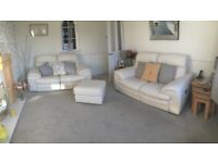 2 x two seater reclining leather Sofas and storage footstool