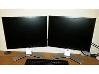 """Two Dell 20"""" Monitors."""
