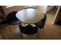 Space-saving dining table and chairs