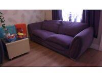 Comfortable dark purple sofa and armchair for sale.