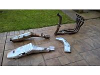 Honda CBR 1000RR 2004. Full exhaust system (no gaskets) including the two heat Shields.