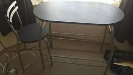dining table and 2 chairs in good condition