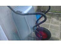 Wheelbarrow, mattock, and grass trimmer