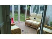 Conservatory settee, two chairs and wicker table