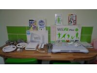 Wii console boxed , Wii fit board (boxed) + games + accessories