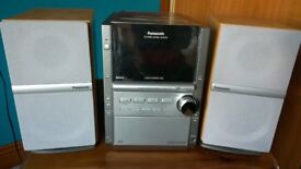 Panasonic Stereo System model no. SC-PM18, speakers, antenna & remote control in very good condition