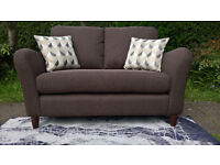 A New Warwick 2 Seater Brown Fabric Material Sofa.