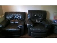 2 black leather armchairs. 1 is a reclining armchair. good clean condition