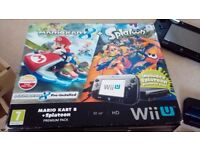 Wii u 32gb Black £140 (with 2 pre installed games +1 extra game)