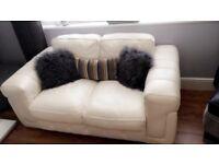 White 2 seater Italian leather sofa