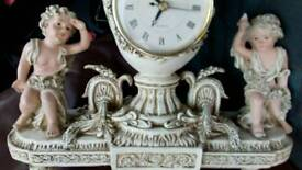 Reproduction clock with cheribs