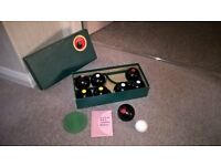 Boxed set of carpet bowls (biased)