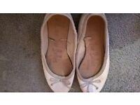 well worn ballerina flat shoes