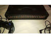An Amp-Tech AP150 multi channel amplifier