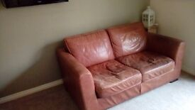 Brown leather 2 seat sofa was £150 now £50 to go asap