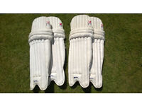 Cricket pads, two sets