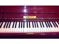 D'este piano. Reasonable condition.