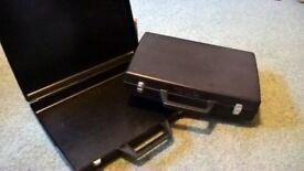 2 child's black plastic brief cases