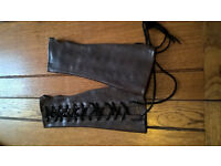 Brown leather effect arm binders / lace up.