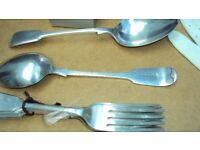 Forks and serving spoons in vintage fiddleback style