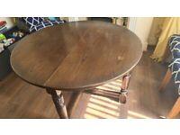 Dark wood round table & 6 chairs