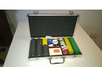 300pcs numbered chips set in aluminium case, a deck of cards, cut cards, dice, dealer button.