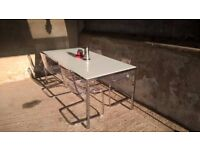 Table and 4 chairs. Glass top chrome frame table with 4 acrylic and chrome chairs.