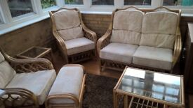 REDUCED-CANE FURNITURE SET 6 PIECES CONSISTING OF TWO ARMCHAIRS, 2 SEAT SETEE, STOOL AND TWO TABLES.