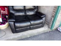 2x2 seater black leather sofas
