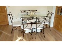 Roman style glass top dining table and 6 chairs