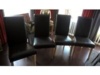 Set of four brown faux leather dinning room chairs