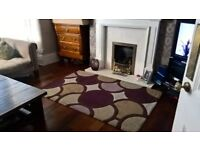 Stunning rug approx 120cm x 170cm Purples, greens and dark brown