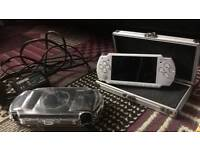 Sony psp with 5 games 1 DVD and 2 cases