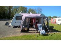 Luxury Quasar Touring caravan 2011 complete ready to go excell;ent condition as hardly used.