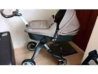 Never used brand new Stokke Xplory v4 brown under warranty with like new carrycot too