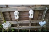 heart shaped, owl and lantern shaped garden accessories.