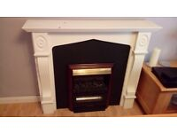 Fireplace, mantelpiece and electric fire