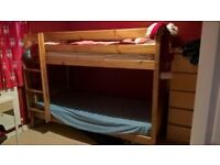 Wooden bunk beds. Mattresses not included.