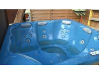 Hot tub. 5 seater. Full size outdoor spa with hardwood timber surround and 16 massage jets